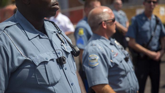Members of the Ferguson Police department wear body cameras during a rally August 30, 2014 in Ferguson, Missouri.(AFP Photo / Aaron P. Bernstein)