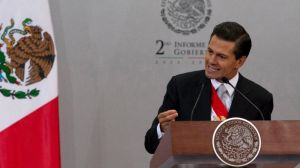 """FILE - In this Sept. 2, 2014 file photo, Mexico's President Enrique Pena Nieto gives his second state-of-the-nation address inside the National Palace in Mexico City. The Mexican president said in an interview with the newspaper El Universal published Friday, Sept 12, 2014, that Texas' decision to deploy National Guard troops along the border is """"unpleasant"""" and """"reprehensible,"""" and could affect bilateral relations. (AP Photo/Eduardo Verdugo, File) (The Associated Press)"""