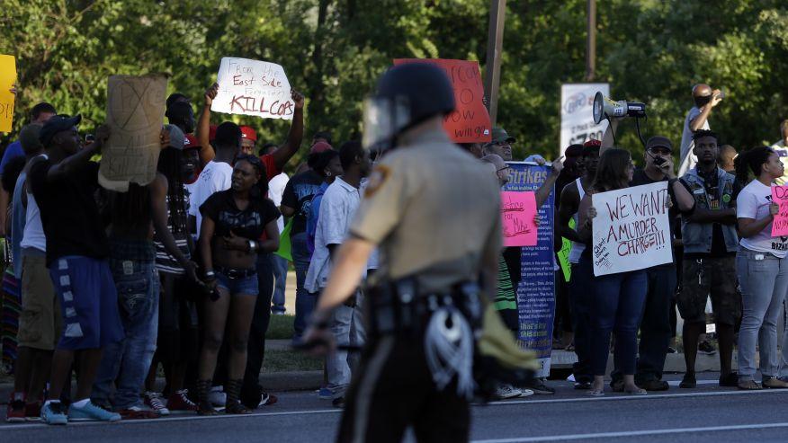 ferguson protest cop