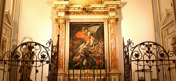 "A Spanish mural of St. James the Apostle, patron saint of Spain, beheading a Muslim in battle. St. James is sometimes called Matamoros, which means ""Muslim killer."" From the Cathedral website: ""It is said that in 844, King Ramiro I had a battle in Clavijo, where he defeated the Muslims, with the help of the appearance of the apostle riding a white horse, as it is represented in the painting of this chapel."" The mural is located in the St. James chapel at at St. Mary's Cathedral, Valencia, Spain – the same church from which St. Juan de Ribera directed the end of Spanish Islam in 1609."