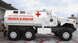 A rendering of the San Diego Unified School District's new MRAP shows it in white, with red ambulance markings. When district police received it, the vehicle was military tan.