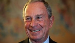 In this Tuesday, Sept. 16, 2014, file photo, former New York Mayor Michael Bloomberg smiles prior to be conferred with the Chevalier de la Legion d'Honneur by France's Foreign minister Laurent Fabius, at the Quai d'Orsay, in Paris. Britain's Queen ...