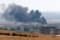 Smoke rises from the Syrian town of Kobani, as seen from near the Mursitpinar border crossing on the Turkish-Syrian border in the southeastern town of Suruc in Sanliurfa province October 6, 2014 (Reuters / Umit Bektas)