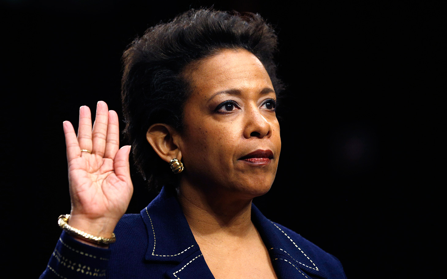 Loretta Lynch is sworn in to testify before a Senate Judiciary Committee confirmation hearing on her nomination to be U.S. attorney general on Capitol Hill in Washington January 28, 2015. Lynch, nominated in November, has stirred little controversy in her 16 years with the U.S. Attorney's office in Brooklyn and is expected to win confirmation.    REUTERS/Kevin Lamarque  (UNITED STATES - Tags: POLITICS CRIME LAW)