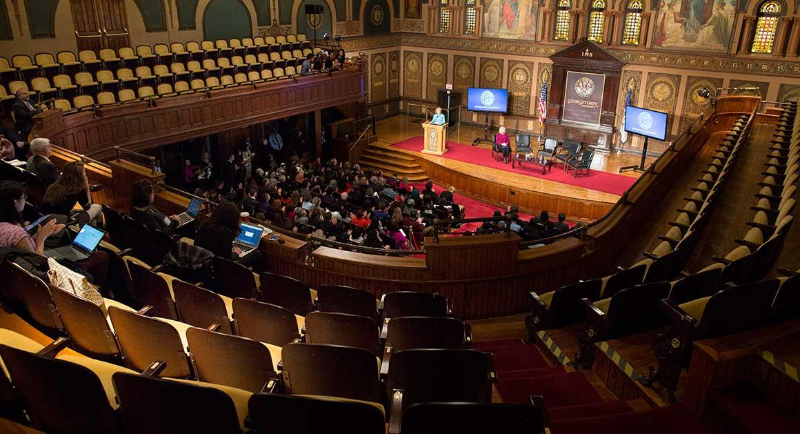 Former Secretary of State Hillary Clinton delivers a policy speech on leadership at Georgetown University Dec. 3, 2014 in Washington, DC. While students were invited, several empty seats remain and the balcony was mostly empty.  (M. Scott Mahaskey/Politico)