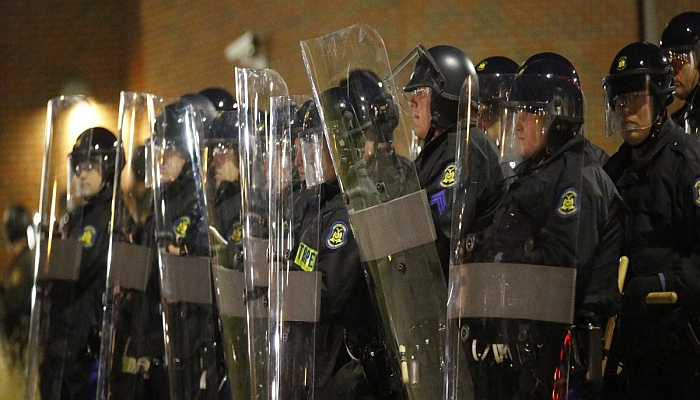 Missouri State Troopers in riot gear stand in formation outside the Ferguson Police Department in Ferguson, Missouri, November 24, 2014. A St. Louis