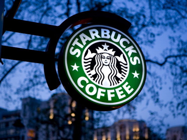 A Starbucks store sign. (Photo by: Newscast/UIG via Getty Images)
