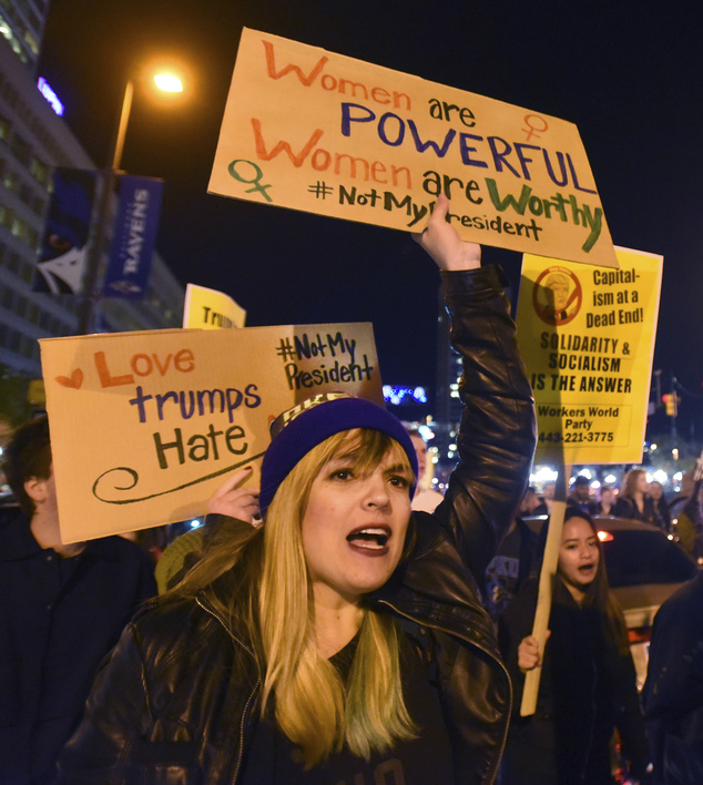 Anti-Trump protesters march from the Washington Monument to Inner Harbor Thursday, Nov. 10, 2016, in Baltimore. Scattered protests around the country continue to follow the unexpected election of Donald Trump as president, with hundreds marching in Philadelphia, Baltimore and Grand Rapids, Mich. (Amy Davis/The Baltimore Sun via AP)