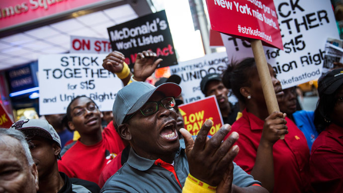 Protesters demanding higher wages and unionization for fast food workers march near Times Square on September 4, 2014 in New York City.(AFP Photo / Andrew Burton)