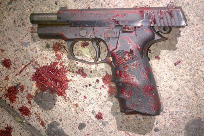 A blood-soaked gun used by Shaaliver Douse, 14, in a shooting that ended with police kiilling him. Photo: NYPD