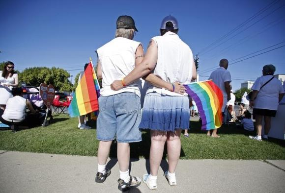 Ann Skinner (L) and her wife Sheila Belka wait for the beginning of the Utah Pride Parade in Salt Lake City, Utah, June 8, 2014. CREDIT: REUTERS/JIM URQUHART