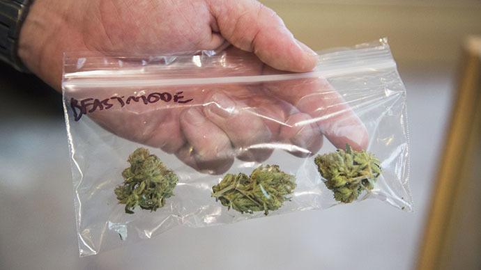 A customer purchases a marijuana strain (Reuters / Jason Redmond)