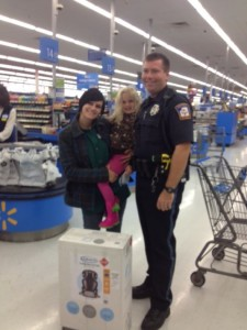 Officer Ben Hall, Lexi DeLorenzo and her daughter with the car seat at Walmart on Friday evening. (Photo: Provided )