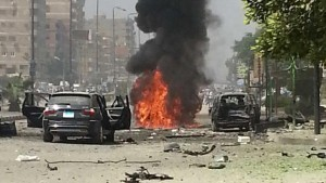 Smoke billows from a burning car moments after Islamist terrorists carried out a suicide bombing attack targeting the convoy of an Egyptian government minister in Cairo in September 2013. (AP Photo/Ahmed Soliman, File)
