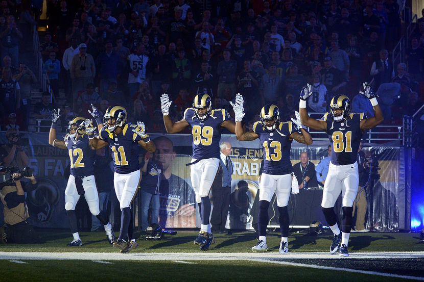 SICKENING VIDEO! St. Louis Rams players come out of the tunnel with arms raised for Michael Brown