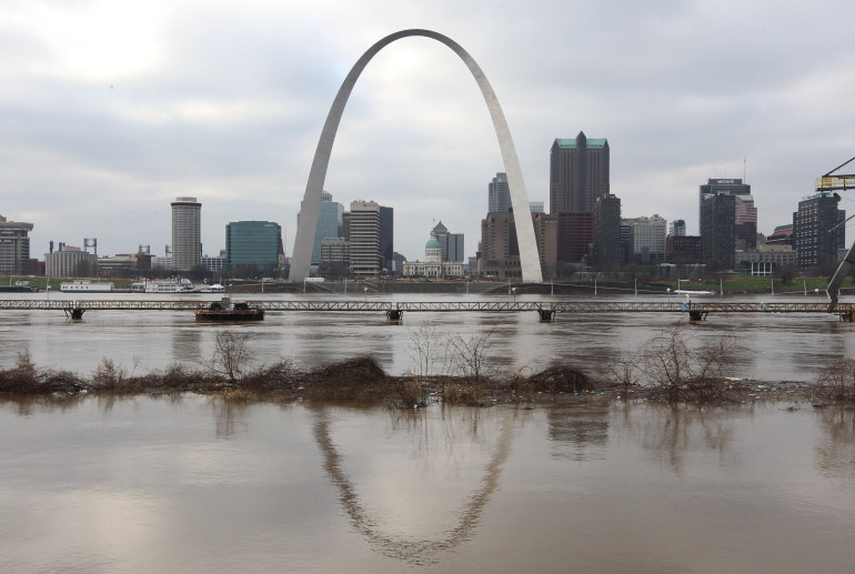 The Gateway Arch in St. Louis is reflected in the near record flood waters of the Mississippi River taken from East St. Louis, Illinois on December 30, 2015. Flooding statewide from three straigh days of rain has caused evaucations, road closures and thirteen deaths.    Photo by Bill Greenblatt/UPI