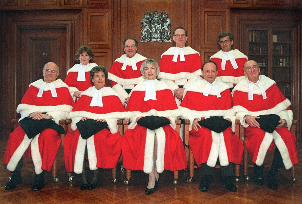 Supreme Court justices pose for an official photograph at the Supreme Court in Ottawa in this Jan 17, 2000 photo, front row (left to right)  Frank Iacobucci, Claire L'Heureux-Dube, Chief Justice Beverley McLachlin, Charles Gonthier, and John Major; Back Row, (left to right) Louise Arbour, Michel Bastarache, Ian Binnie, and Louis LeBel. Prime Minister Jean Chretien announced Thursday that Deschamps, 49, will replace Justice Claire L'Heureux-Dube, 74, who retired July 1 after 15 years at the Supreme Court of Canada. (CP PICTURE ARCHIVE/Tom Hanson)
