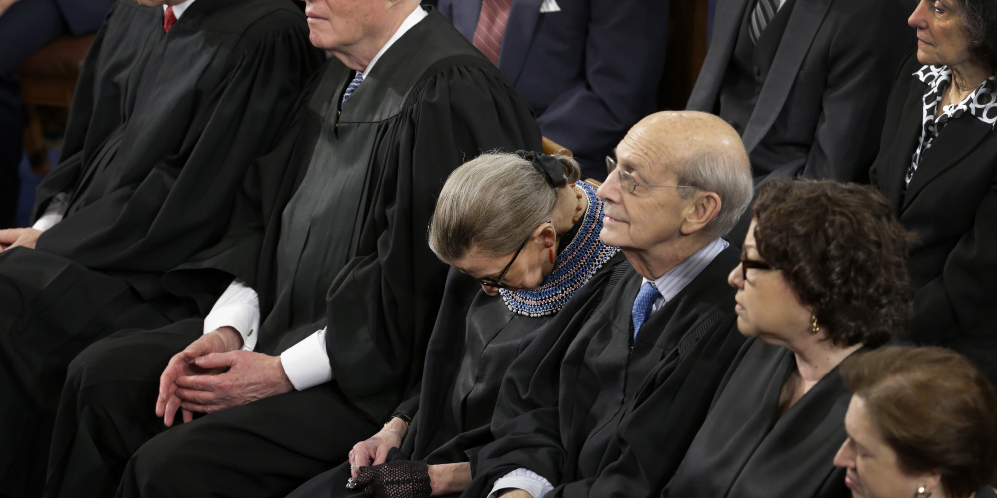 "In this photo taken Jan. 20, 2015 members of the Supreme Court, including Justice Ruth Bader Ginsburg, center, rests during President Barack Obama's State of the Union address on Capitol Hill in Washington. Ginsburg has a confession: She ""wasn't 100 percent sober"" when she fell asleep at the president's State of the Union address last month. Ginsburg told an audience Thursday that she drank some wine at dinner before attending the speech, where cameras repeatedly caught her nodding off. The 81-year-old justice says she had dined with Justice Anthony Kennedy and couldn't resist the California wine he brought.  (AP Photo/Pablo Martinez Monsivais)"