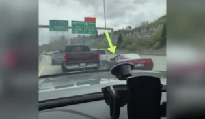 Corvette Driver Refuses To Let In Truck Then Flips The Bird, Gets 'Smoked Out'